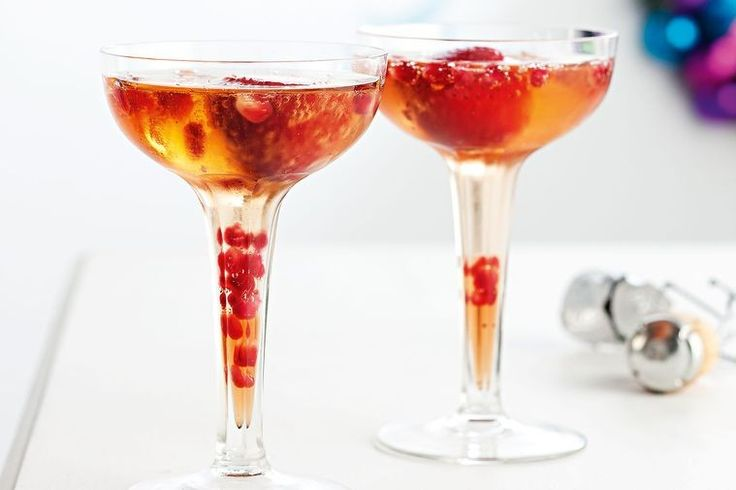 Sparkling cocktail with iced strawberries
