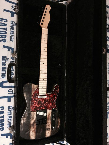"Hand built tele with a custom paint/stain job with the following upgraded hardware:  -JBE Danny Gatton T-Style tele pickups -Gotoh Locking Tuners -10.5 mm ""Dual Load"" tele bridge  -Orange Pearl 3-ply pickguard -Hardshell locking case included  Functionality:  Full copper shielding allows absolutely no audible static during play or plug-in  Specific strings of your choice will be included for free upon sale."
