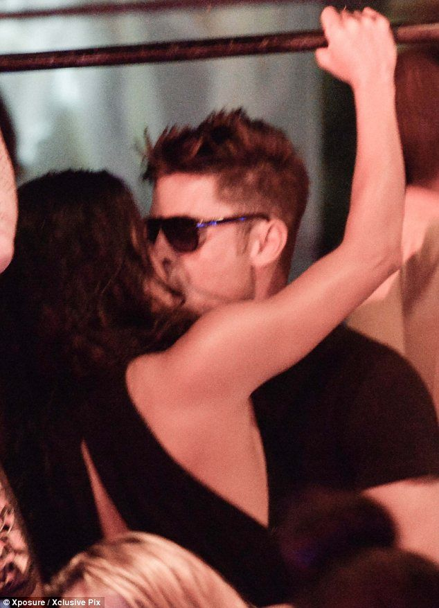 Heating up: Zac Efron planted a kiss on Michelle Rodriguez at a nightclub in Porto Cervo, Sardinia on Monday