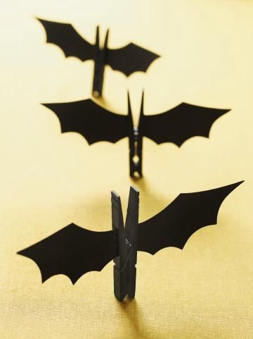 """<div class=""""page""""> <div class=""""section""""> <div class=""""layoutArea""""> <div class=""""column""""> <p>Our easy-to-make bats are defrightful! Painta wooden clothespin black using acrylic paint. While it's drying, go to familyfunmag. com/printables, download our wing template, and cut it out. Use a pencil to trace two wings onto black card stock. Cut them out. Fold over a tab on the base of each wing where shown and glue them to the sides of the clothespin.</p> </div> </div> </div> </div>"""