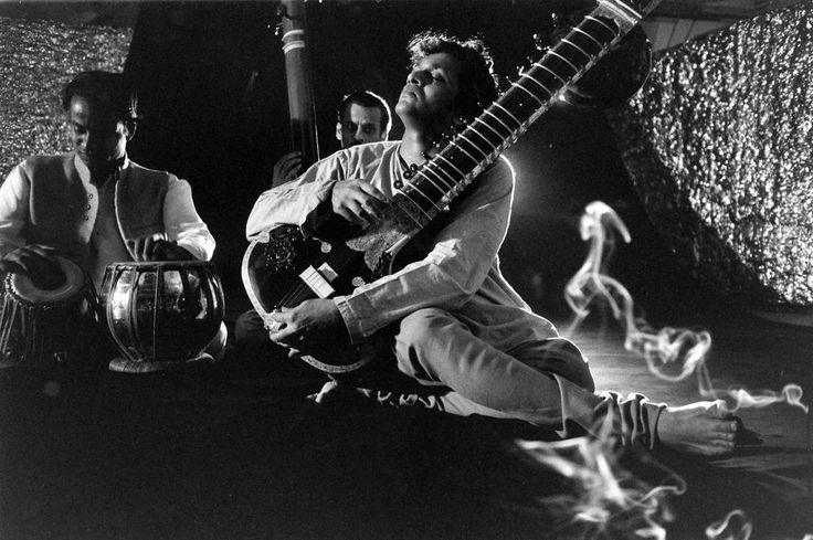 Paul Schutzer—The LIFE Picture Collection/Getty Images Ravi Shankar plays at a party in his honor in New York City, 1956.