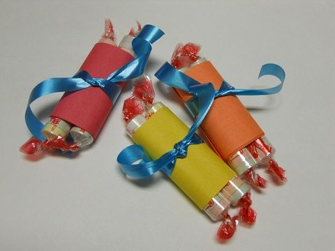 Scroll craft idea (image only, link didn't work for me). Looks like they used 2 Smarties candies, construction paper, and ribbon.