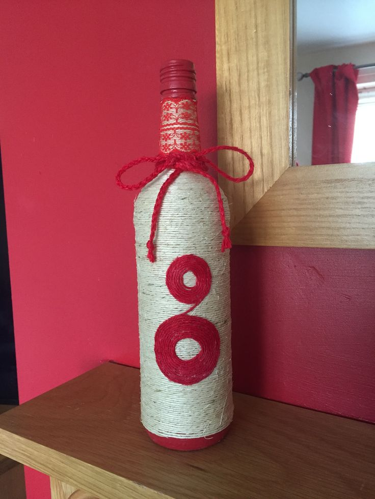 String bottle with red string pattern red lace and a bow .. Lovely