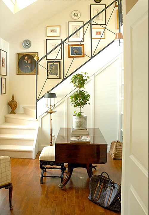stairs-I like the iron rail in this traditional look-keeps it open and makes it unique. And of course I love the white paneling. also the cute small stairs-not practical, but CUTE. might need to put in a huge upstairs french door to haul in furniture!