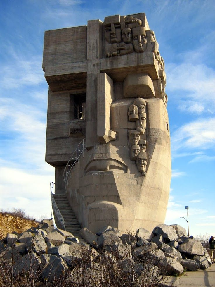 Monument. The Mask of Sorrow. Location: Near Magadan, Russia. The design was created by famed sculptor Ernst Neizvestny, whose parents fell victim to the Stalinist purges of the 1930s; the monument was constructed by Kamil Kazaev. The mask stands 15 metres high and takes up 56 cubic metres of space.