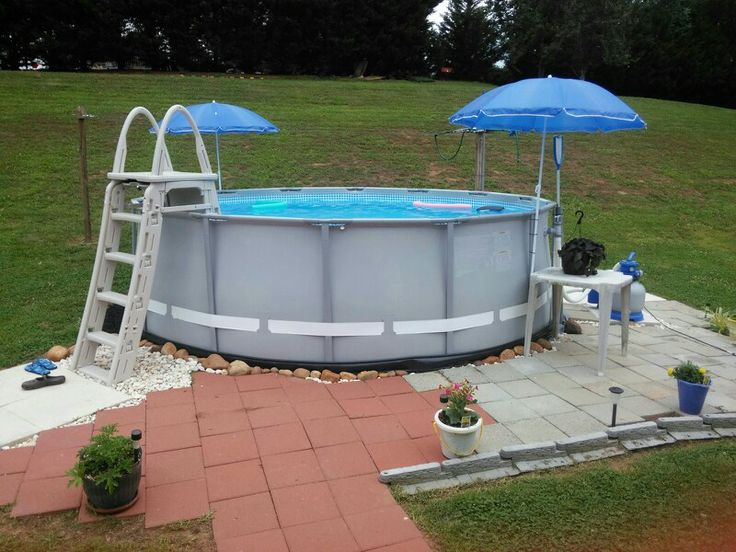Intex soft side pool landscaped by wrapping black soft for Above ground pool border ideas