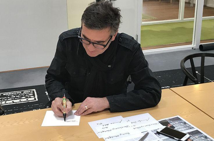 "Mischa Kuball signing the limited eddition of ""Translocating ELEVHØJHUS, 2017"" rugs at DANSK WILTON"