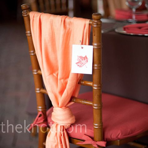Orange Pashmina Favors... I love the idea of giving these out for people to keep warm, and they double as chair covers here!