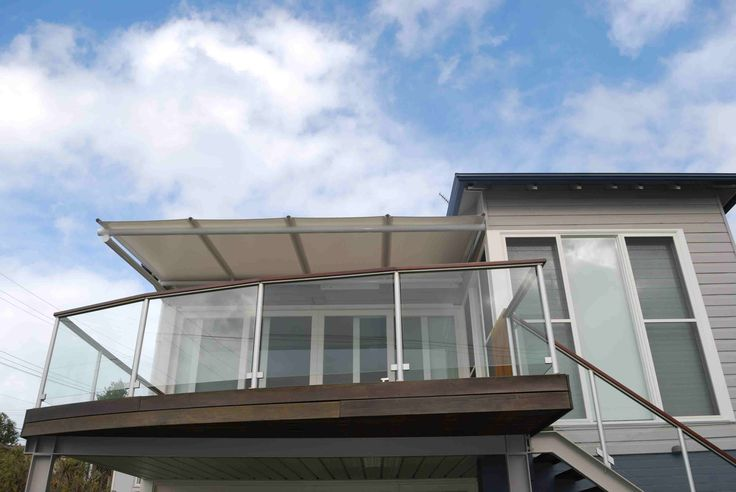 Batten awning for deck with a cantilevered arm