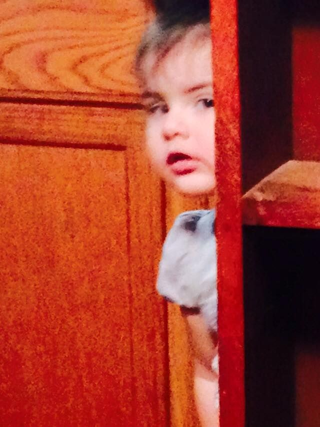 My Granddaughter Nora trying to hide.