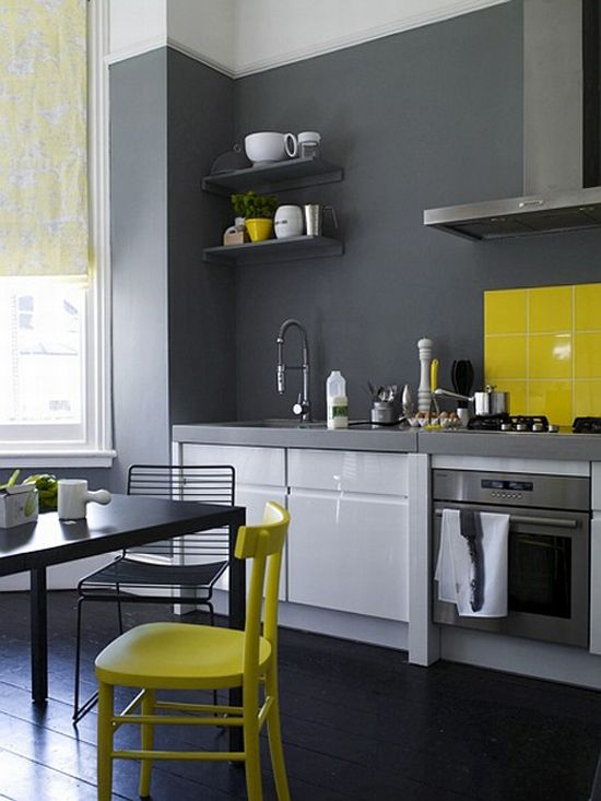 Charcoal kitchen with accents of white and yellow. Color washing with pops of color