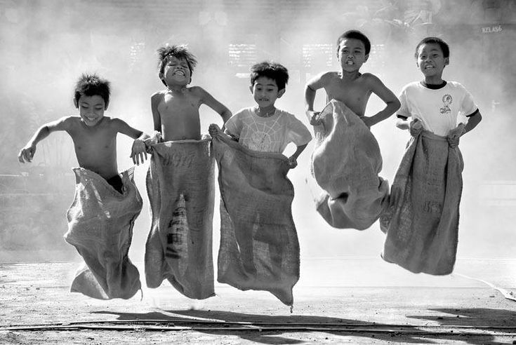Boys engaged in a vigorous Sack Race. What a great action photo, and who doesn't remember doing this at least once when you were young? I love it! ~Skye ....(photographer, date, & location unknown).