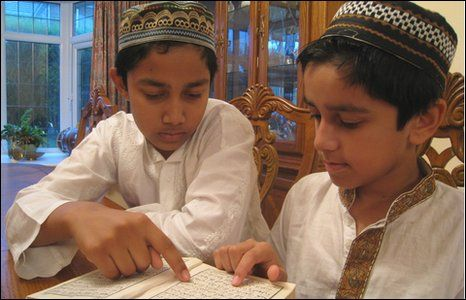 Akash and Aamir reciting the holy Quran.