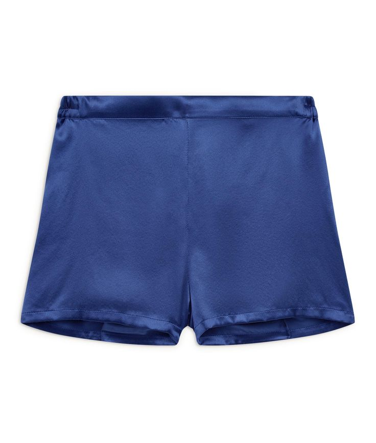 Lotus Indigo Silk Shorts £139 - One of our favourites, these perfect Blue Silk Pyjama Shorts – with just a hint of retro inspiration – are short enough to be sexy but long enough that you won't mind opening the front door. They sit just below the waist but are not low cut and the smooth, flat fronted waistband and softly elasticated back mean they fit like a dream. Wear them at night, in the morning or to add a bit of zap to an evening jacket.