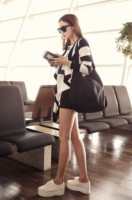 Black and white striped drape sweater and short shorts.