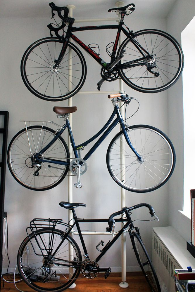 Ikea hack bike rack- We need this in our garage! We have 3 adult bikes, 2 kid bikes, a bike trailer, a jogging stroller, a red wagon, and 3 scooters taking up half our floor space right now.