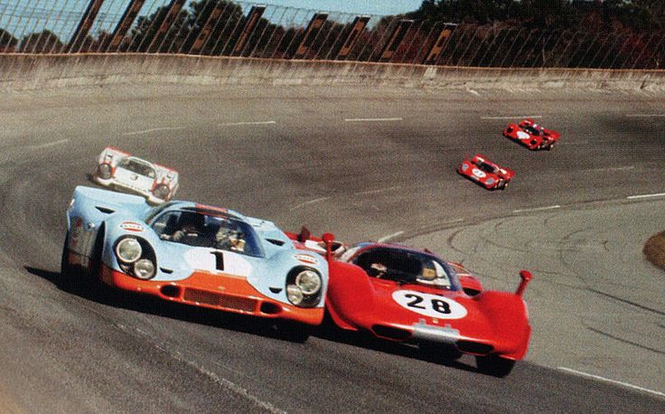 Legendary racing at Daytona 1970 ~ Gulf 917 of Jo Siffert door to door with Mario Andretti in his Ferrari 512 S