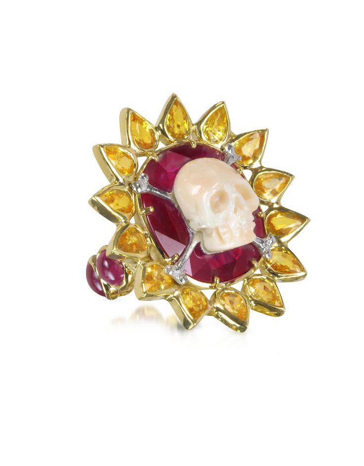 Polished 18-karat gold skull bone ring surrounded by a sunflower design with sixteen petal-shaped yellow sapphires. Featuring six cabochon cut rubies around band. Slip-on design. Other sizes are available upon request. Made in Italy. Note: GOLD 24.10gr (18K), 1RUBY 30.42ct, 6RUBY 8.12ct, 16Y.SAFF 7.20ct #jewelry #fashion #style #women #decoration #gem