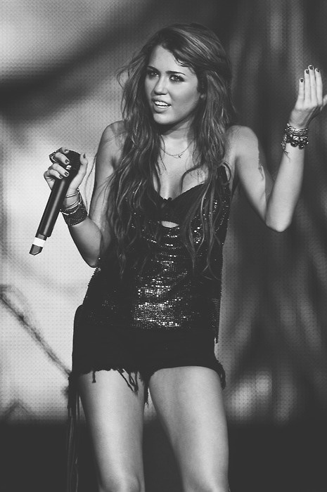 Miley Cyrus's bod. and HER OLDDDD HAIR! i dont know why she would chop off all her hair right before her wedding!