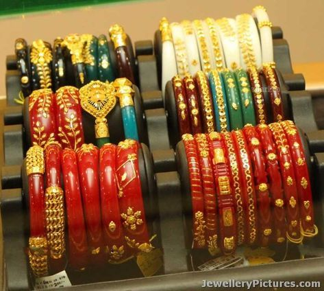 Traditional Bengali Wedding Bangles are exclusive designs.The white bangle is cut from a conch shell, and the red one is traditionally made of red coral. The red, white and iron bangle denotes the marital status of a Bengali woman.in West bengal they are reffered as shakha pola bangles and usually mix it up with loha …