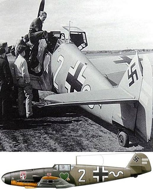"Johann ""Hans"" Halfmann enters the cockpit of his Messerschmitt Bf 109 F-4 of 7./JG 54 at Kotly, Finland, in July 1942. He had been credited of 13 confirmed victories."