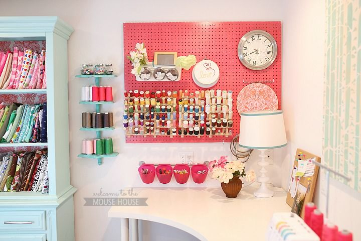 I like how the wallpaper n the back of the hutch coordinates with the color on the pegboard.  Ties it all together!