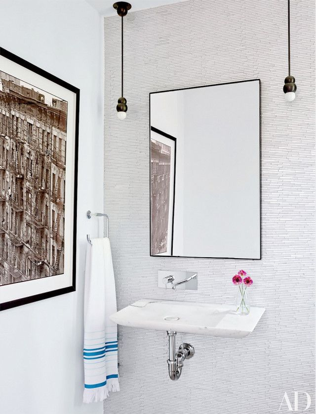 Were it not for the statement mosaic tile wall, this chic powder room would have been like any other. The design team at Leroy Street Studio gave this bathroom a stunning edge by...