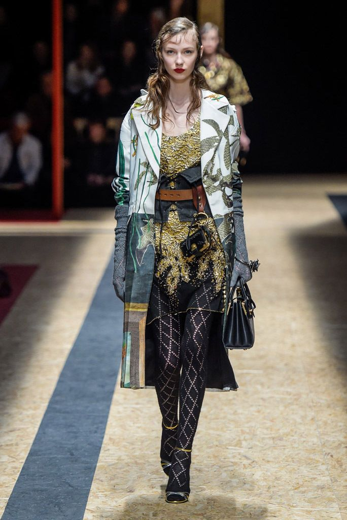 Prada #48 - looks like diamond pattern on the elbow length gloves and tights.