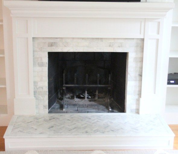 Fireplace makeover | How to tile over a brick hearth with marble herringbone | www.shineyourlightblog.com