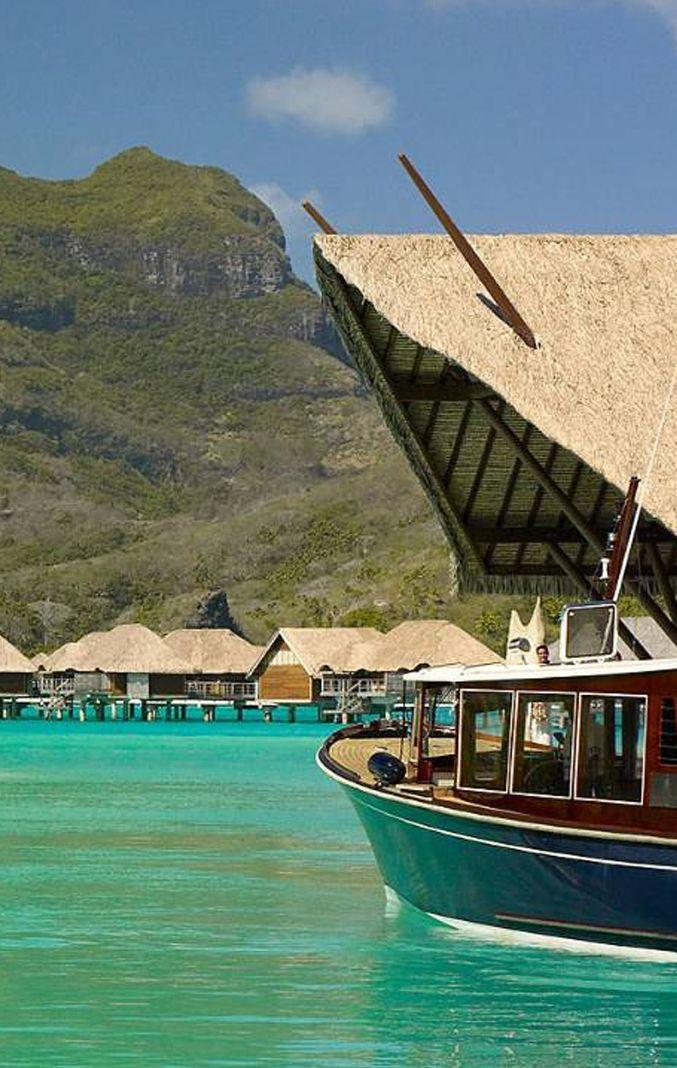 Arrive to four Seasons Bora Bora by a lush boat ride