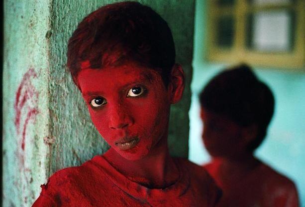 INDIA. Mumbai (Bombay). 1996. Red Boy during Holi festival. Published by Magnum Photos.