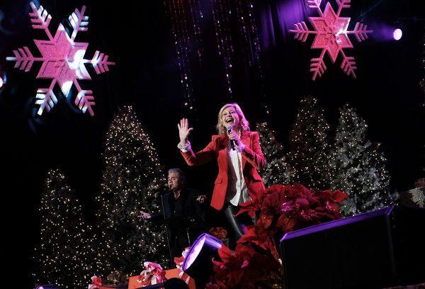 Olivia Newton-John Photos Photos - Olivia Newton John performs at the 85th annual Hollywood Christmas parade on Hollywood Boulevard in Hollywood, on November 27, 2016. / AFP / CHRIS DELMAS - Olivia Newton John Performs at the Hollywood Christmas Parade