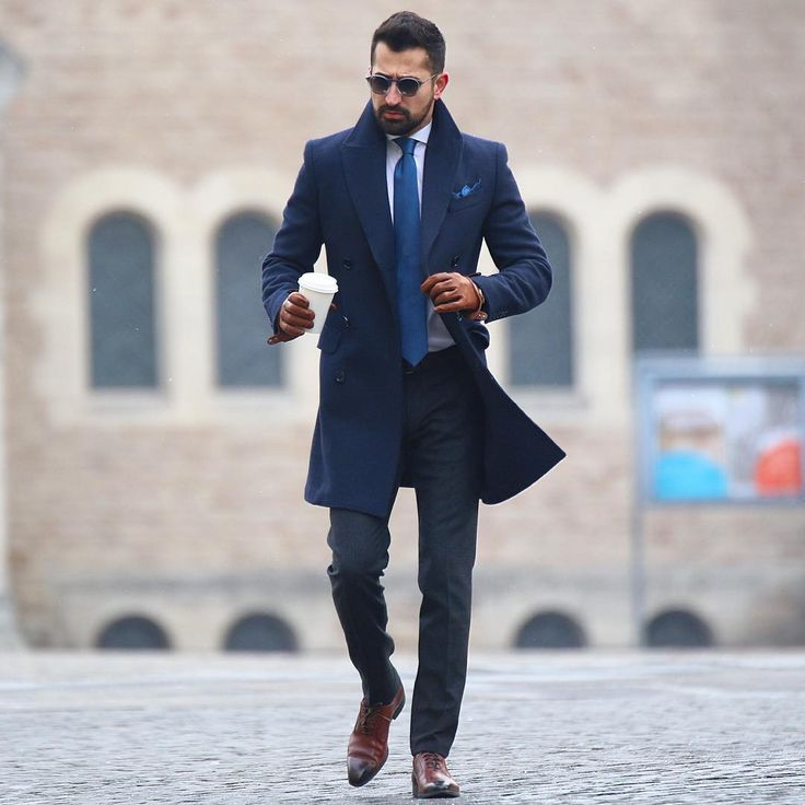 men's navy coat, blue tie, brown oxford shoes
