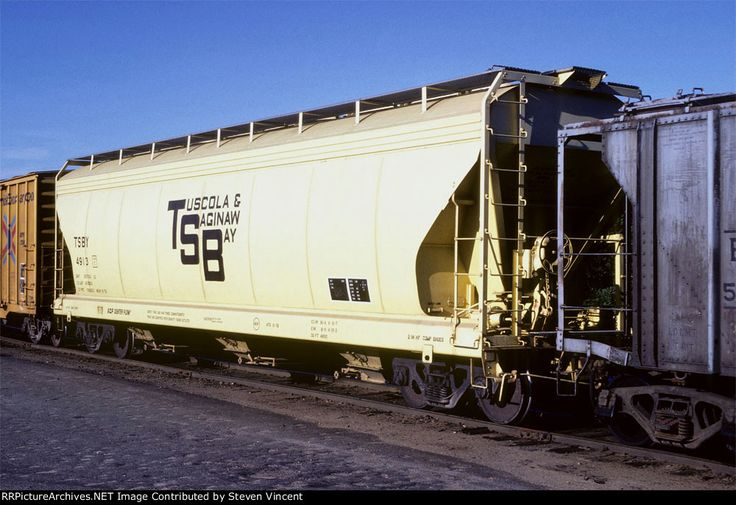 Tuscola & Saginaw Bay Rly covered hopper #4913           TSBY 4913  Date: 9/6/1980Location: Manchester, NH   Map Show Manchester on a rail mapViews: 16Collection Of:   Steven Vincent  Rolling Stock: TSBY 4913 (Covered Hopper)Author:  JJ Ruediger