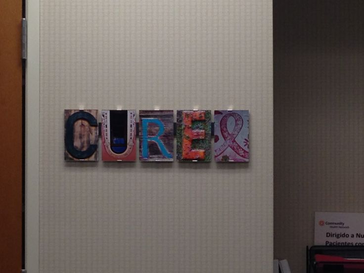 """CURE"" hangs in the breast cancer office at Community Hospital"