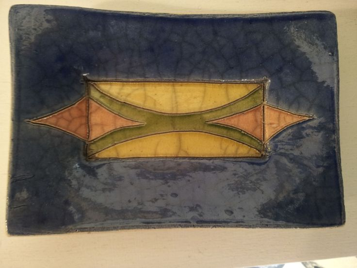 the raku tecnique and the traditional african design...The Fenix ceramics available at UBUNTU Project Store. Small rectangular plate