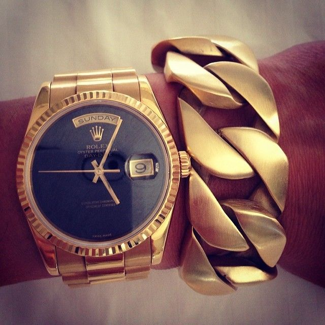 The huge chunky brushed gold bracelet is to die for and one day i will have a rolex