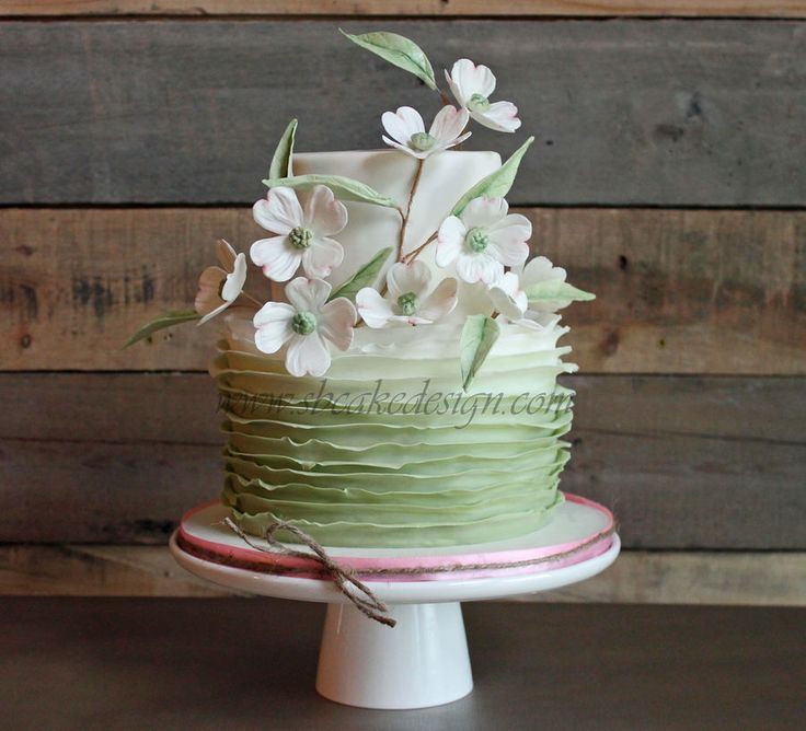 Ombre ruffles with gumpaste dogwoods and leaves on this pretty little cake.  ~ all edible