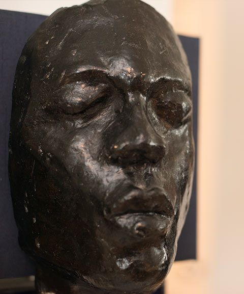 A black sculpture of a face sits in the home of Charlie Casely-Hayford