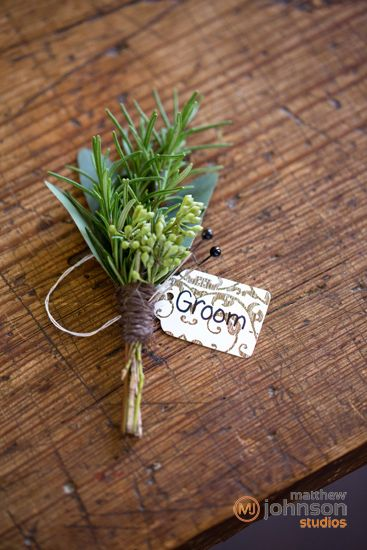 The fathers and ring bearer will have boutonnieres of greenery wrapped in raffia with the stems showing.