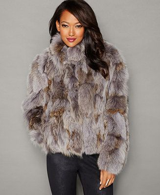 Amp up your glam factor in The Fur Vault's luxe coyote fur jacket-- make a stylish statement this winter! | Real coyote fur; lining: polyester | Professional fur clean only | Imported | Genuine dyed,