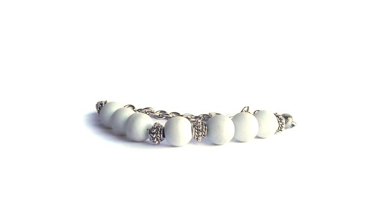 White with chain and adjustable.   To find price visit website