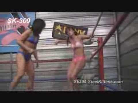 Female Wrestling   Belly Punches   Bear Hugs   Choke Holds  http://www.Steelkittens.com #femalewrestling #bellypunch #bearhug #chokehold