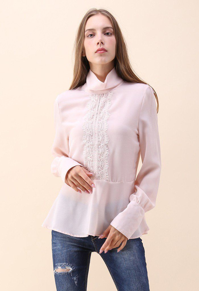 Everyone will be thankful you walked a beautiful vision into the room when you strut around in this pink smock top with long sleeves and lovely lace.  - Lace patch trimming  - Turtleneck  - Buttoned cuffs - Keyhole cutout with button to reverse - Not lined - 100% Polyester - Hand wash cold  Size(cm)Length  Bust  Shoulder  Sleeves S/M                64       92         40          62 Size(inch)Length Bust  Shoulder  Sleeves S/M                25       36        15.5        24.5  * S&...