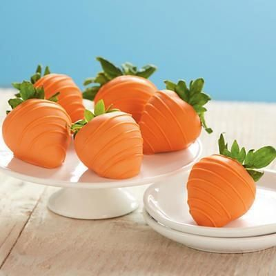 Strawberries dipped in white chocolate with orange food coloring to make 'carrots' for Easter... Too cute!