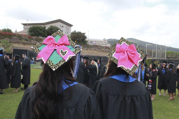 Big pink bows. Mortarboard decorations. CSUSM graduation cap decor. | California State University San Marcos Commencement 2013