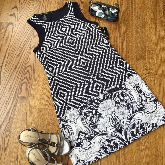 NWT INC Safari Chic dress International Concepts NWT Safari Chic fully lined dress. Size medium. Shell is 61% cotton, 38% polyester, 1% spandex. Lining 100% polyester. There is some stretch. Super cute, wish it fit me!!!! Colors are navy and ivory. INC International Concepts Dresses
