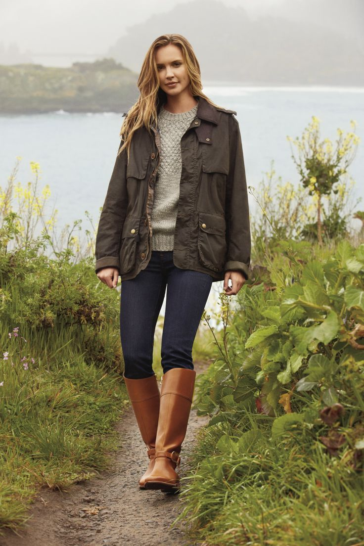 Dark wash jeans, riding boots and bulky sweater.