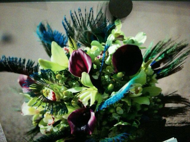 Gorgeous jewel tones with the glamour of peacock feathers, green orchids and purple calla lilies.