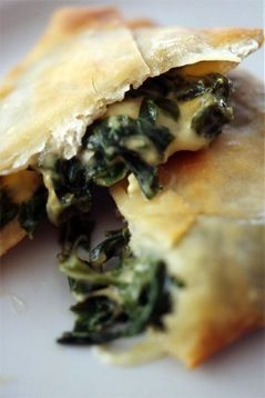 Kaltsounia... really fine fyllo pastry with a filling of wild greens and herbs, with fresh myzithra cheese and free range eggs, for consistence... Lovely